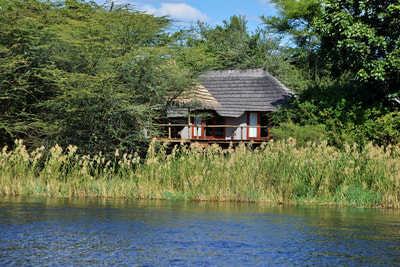 Chalet viewed from the river at Chobe Bakwena Lodge, Botswana