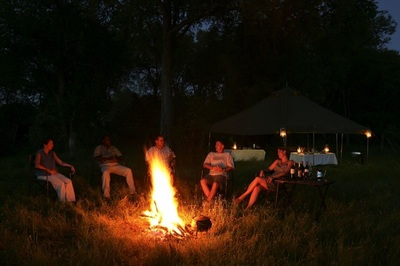 Sitting around the campfire on your Northern Highlights Safari, Botswana