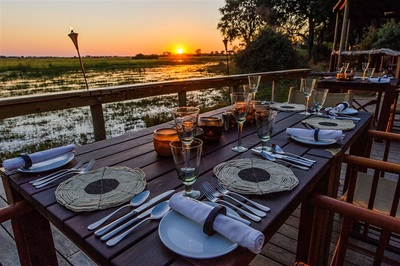 Mombo Camp dinner set-up and view of the lagoon, Botswana