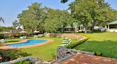 Pool area and gardens, Batonka Guest Lodge, Victoria Falls