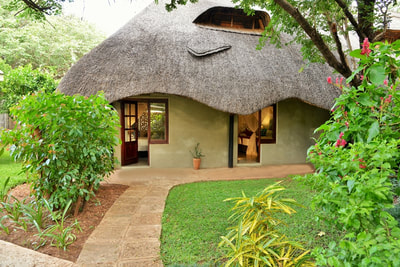 Thatched Chalet accommodation at Bayete Guest Lodge, Victoria Falls