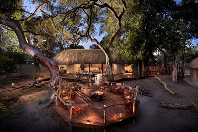 View of fire pit and main lodge at Khwai Bush Camp, Botswana