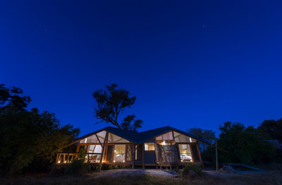 Luxury tented accommodation at night, Splash Camp