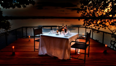 Private dining overlooking the lagoon at Xugana Island Lodge, Botswana